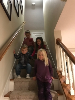 Big kids helping Amos manage the stairs :)